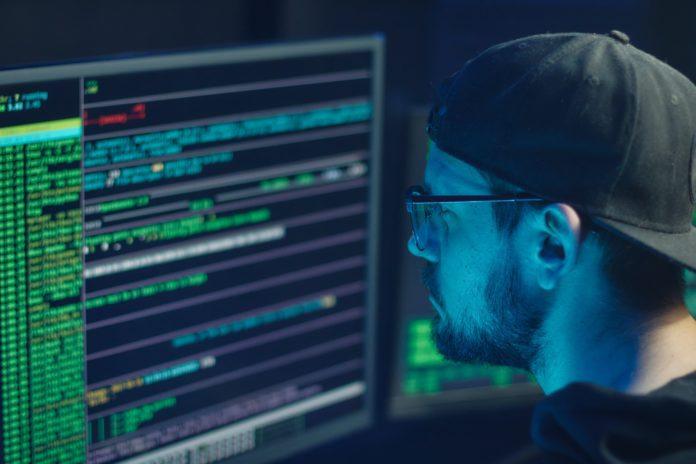 man looking at computer code