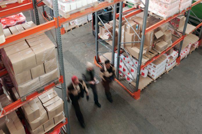 men walking through warehouse