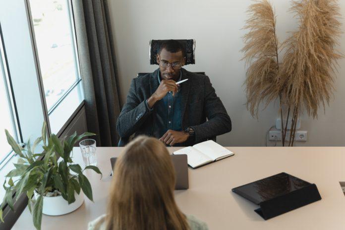 man hiring IT worker